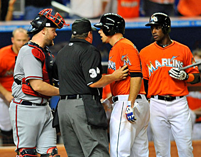The Marlins' Jose Fernandez (right) has words with Braves catcher Brian McCann after hitting his first career homer. (USATSI)