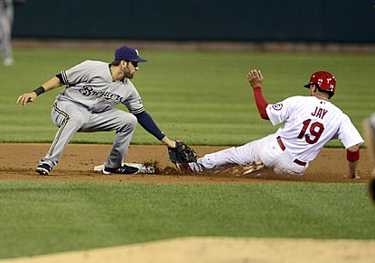 Milwaukee shortstop Jeff Bianchi tags out Jon Jay on a stolen-base attempt in the first inning.  (USATSI)