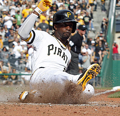 Andrew McCutchen scores the go-ahead run for Pittsburgh in the 8th inning. He reaches base after getting hit by a pitch. (USATSI)