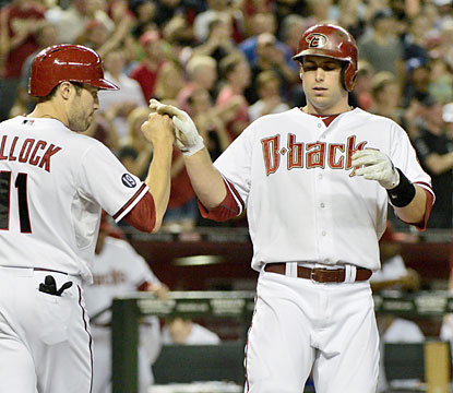 Paul Goldschmidt (right) puts the Diamondbacks up for good with his two-run home run in the first inning against the Dodgers. (USATSI)