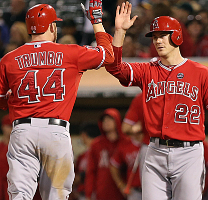 Mark Trumbo and Mike Trout each homer in the eighth inning as the Angels put a beating on the A's.  (USATSI)