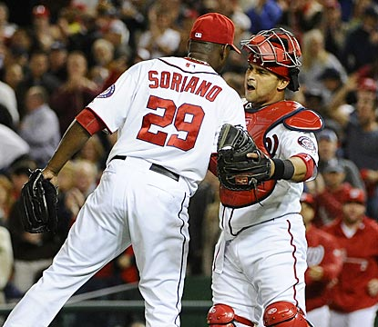 Closer Rafael Soriano and catcher Jhonatan Solano celebrate the Nationals' 21st victory in their past 27 games.  (USATSI)