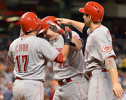 Shin-Soo Choo (left) and Joey Votto (right) congratulate Jay Bruce on his grand slam in the fourth inning.  (USATSI)