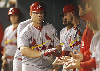 Matt Holliday gets another dugout welcome after his home run in the fifth inning pushes St. Louis' lead to 10-0.  (USATSI)
