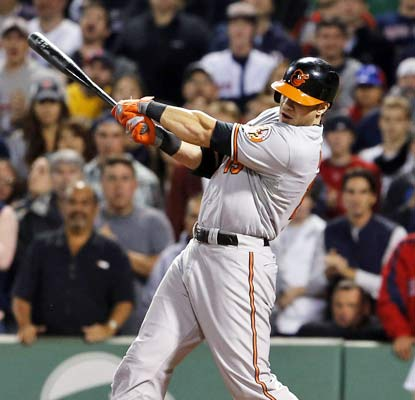 Chris Davis grounds a single up the middle and drives in the winning runs for the Orioles in the 12th inning.  (USATSI)