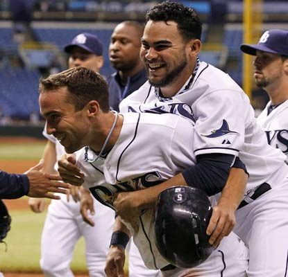 The Rays pull off another dramatic win at home and now lead the wild-card race, supplanting the Rangers.  (USATSI)