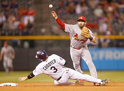 Cardinals shortstop Daniel Descalso turns a double play in the first inning despite Michael Cuddyer's attempt to break it up.  (USATSI)