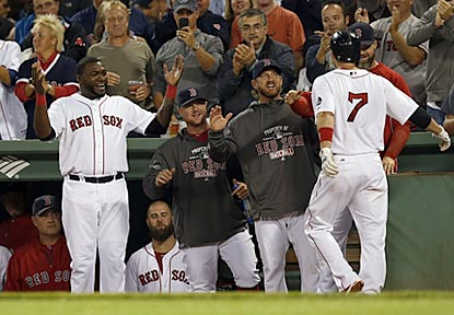 David Ortiz leads the welcoming committee for Stephen Drew after his two-run roundtripper in the second inning.  (USATSI)