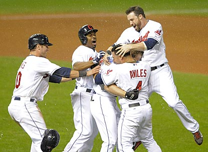 Indians teammates mob Matt Carson after he delivers a walk-off single in the 11th inning.  (USATSI)