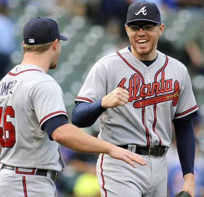 Craig Kimbrel and Freddie Freeman celebrate after the Braves put up four runs with two outs in the ninth inning.  (USATSI)