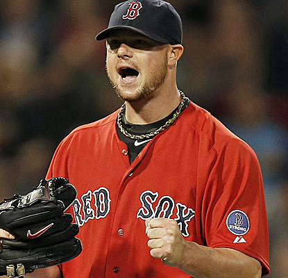 Jon Lester goes seven innings to pick up the win as the Red Sox finish their worst-to-first turnaround.  (USATSI)