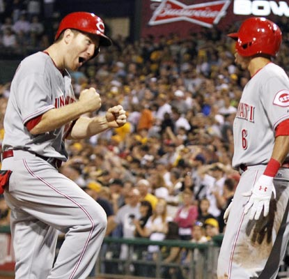 Todd Frazier (left) and Billy Hamilton are pumped after rallying to tie the Pirates in the bottom of the ninth.  (USATSI)