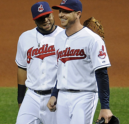 The Indians are all smiles after knocking off the Astros to maintain their grip on the second wild-card spot.  (USATSI)