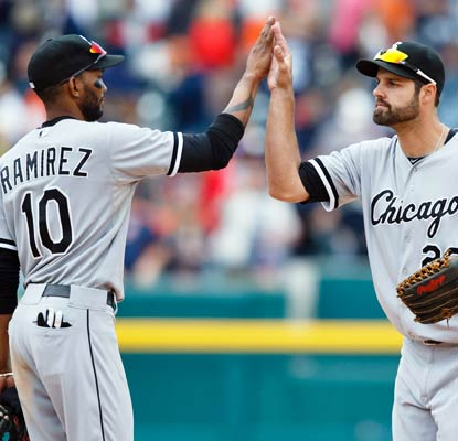 Alexei Ramirez and Jordan Danks make sure there is no AL Central championship celebration in Detroit on Sunday.  (USATSI)