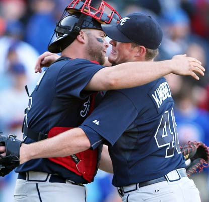 Brian McCann and Craig Kimbrel embrace their division championship after securing a win at Wrigley over the Cubs.  (USATSI)