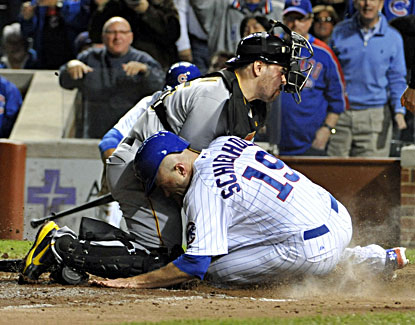 Russell Martin (left) tags out Chicago's Nate Schierholtz at home plate to end the game. (USATSI)
