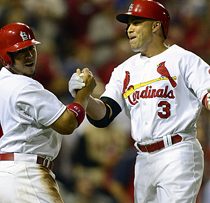 Carlos Beltran is greeted after his two-run homer as the Cardinals officially end the Nats' postseason hopes.  (USATSI)