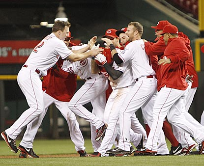 The Reds celebrate their victory, and minutes later find out they will make a return trip to the postseason.  (USATSI)