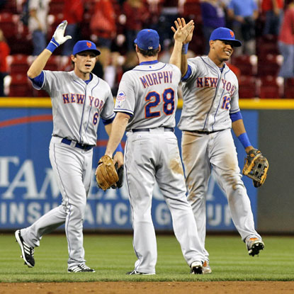 Daniel Murphy, Matt den Dekker and Juan Lagares celebrate the Mets' 4-2 win over the Reds. (USATSI)