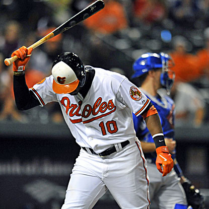 Adam Jones slams the bat down after striking out in the 10th inning in the loss to the Blue Jays. (USATSI)