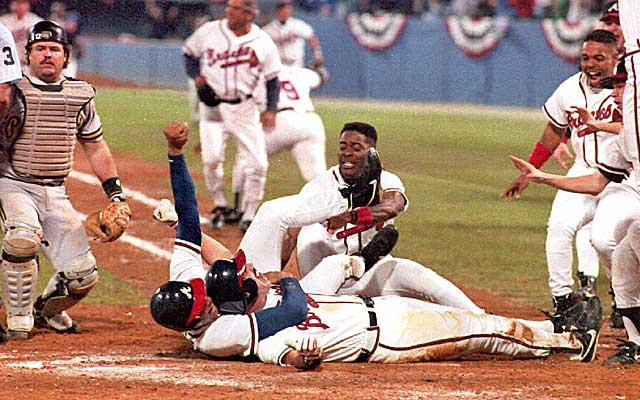Sid Bream and the Braves celebrate after his winning slide in Game 7 of the 1992 NLCS. (Getty Images)