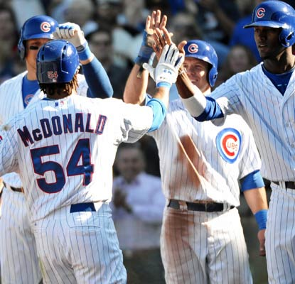 Darnell McDonald's three-run home run is the decisive play as the Cubs deal the Pirates a loss at Wrigley Field.  (USATSI)