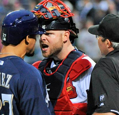 Brian McCann is unhappy with Carlos Gomez after his homer in the first inning, sparking a benches-clearing altercation.  (USATSI)