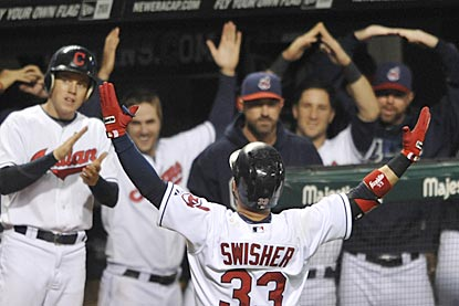 Nick Swisher, who played at Ohio State, spells out 'O-H' for Indians fans after hitting a home run in the fifth inning.  (USATSI)