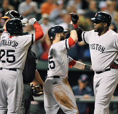 David Ortiz knocks a three-run shot as the Red Sox look to win home-field advantage throughout the playoffs.  (USATSI)