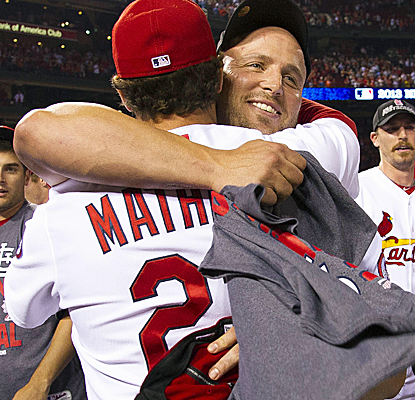 Cards manager Mike Matheny and Matt Holliday celebrate St. Louis' victory over the Cubs to clinch the NL Central.  (USATSI)