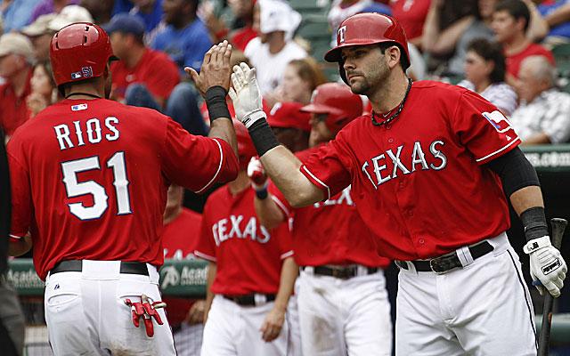 Mitch Moreland congratulates Alex Rios after he scored a run for the Rangers. (USATSI)