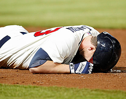 Chris Johnson fails to beat out his grounder to deep short, ending the Braves' 9th-inning rally. (USATSI)