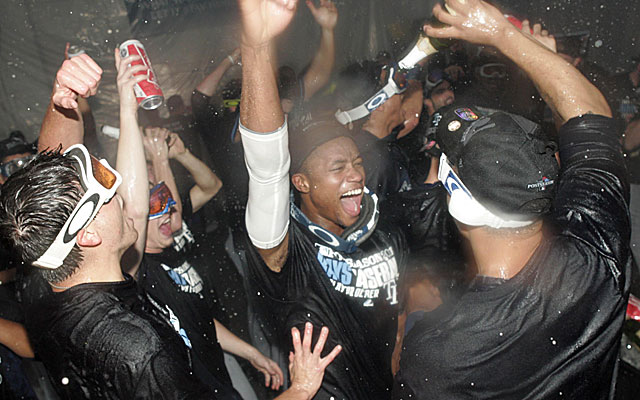 The Rays celebrate their wild-card playoff win over Texas with champagne showers. (USATSI)