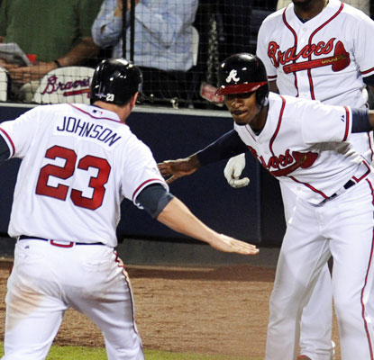 Chris Johnson and B.J. Upton score on Jason Heyward's key 2-run single to put the Braves up 4-1 in the seventh.  (USATSI)