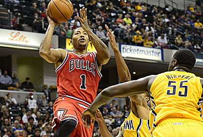 Derrick Rose scores 13 points in 20 minutes in his first game since tearing his left ACL two seasons ago. (USATSI)