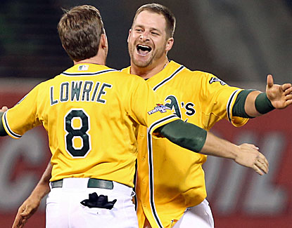 Oakland's Stephen Vogt's celebrates his winning single with Jed Lowrie, ruining a stellar game from Justin Verlander. (USATSI)