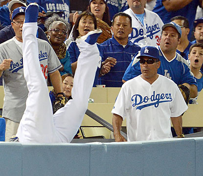 Carl Crawford, who makes a catch before falling over the railing, makes plays on both offense and defense in the blowout win. (USATSI)