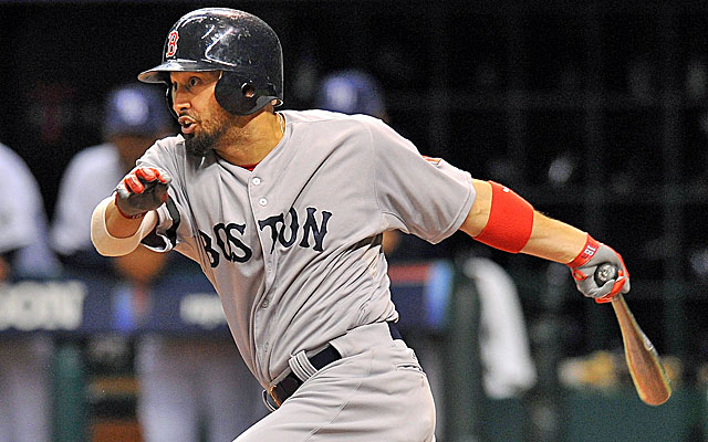 Shane Victorino legs out an infield single to drive in the go-ahead run for the Red Sox. (USATSI)