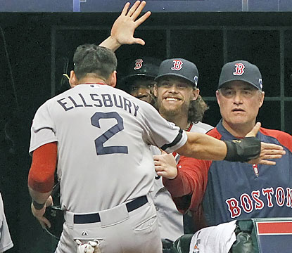 Boston teammates greet Jacoby Ellsbury, who scores the go-ahead run in the seventh inning.  (USATSI)