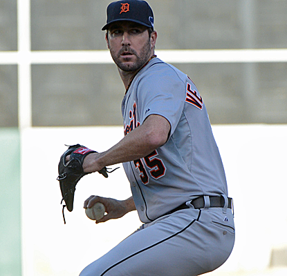 Justin Verlander strikes out 10, giving up just two hits over eight innings to send Detroit to the ALCS.  (USATSI)
