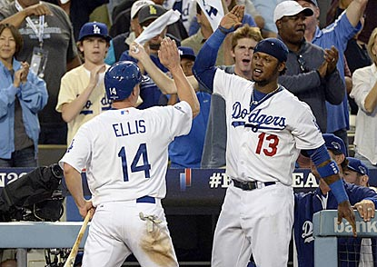 AJ Ellis receives congratulations from Hanley Ramirez after scoring the Dodgers' first run in the fourth inning.  (USATSI)