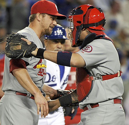 Catcher Yadier Molina congratulates Trevor Rosenthal, who closes out the Dodgers to give the Cards a commanding 3-1 NLCS lead. (USATSI)