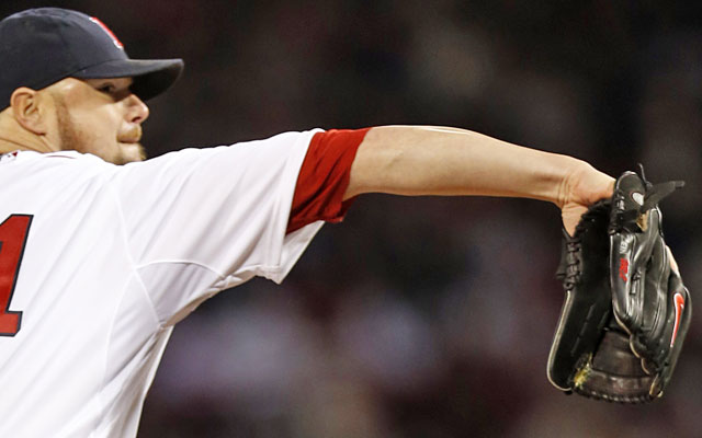 Jon Lester says he keeps a rosin bag in his glove between starts, leading to the 'green booger' near his thumb. (USATSI)