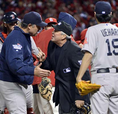 John Farrell looks for an explanation after an unforgettable ending to Game 3 that gives the Cards a 2-1 series lead.  (USATSI)