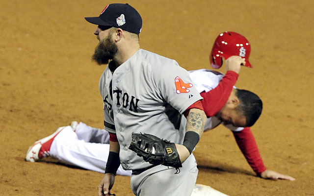 Boston find ways to win, and it ends with Koji Uehara's game-ending pickoff of Kolten Wong. (USATSI)
