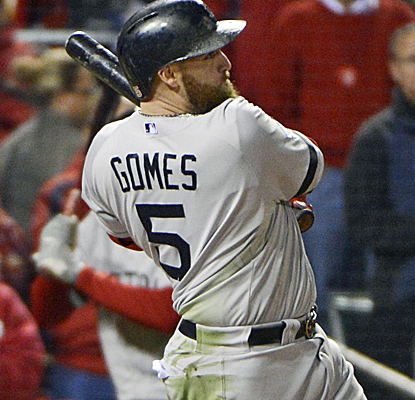 Jonny Gomes connects off Seth Maness for the game-turning three-run roundtripper in the sixth inning.  (USATSI)