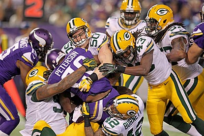 For the third consecutive game, Adrian Peterson gets fewer than 15 carries, and the Packers limit him to 60 rushing yards.  (USATSI)