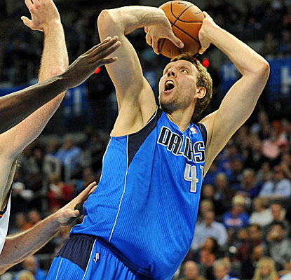 Dirk Nowitzki, who finishes with 17 points, pulls his patented fall-away during the Mavs' win in OKC.  (USATSI)
