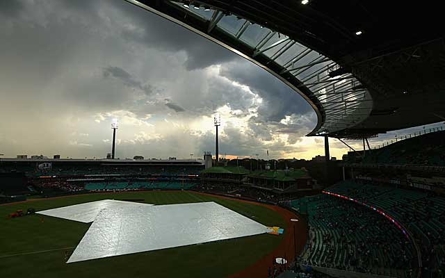 The MLB-fashioned field at the Sydney Cricket Grounds experiences its first rain delay. (USATSI)