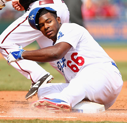 Yasiel Puig gets caught off first base but contributes three hits and two RBI in the Dodgers' victory.  (Getty Images)